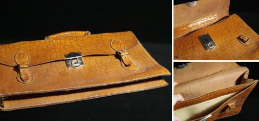 Old shoolbag made of brown leather
