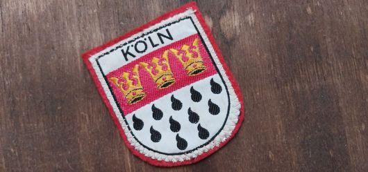 Old fabric badge cologne