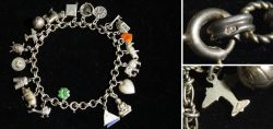 Old Charm Bracelete made of silver with 20 different charm