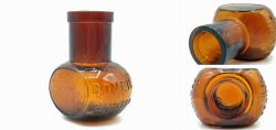 Brown glass bottle with embossed inscription